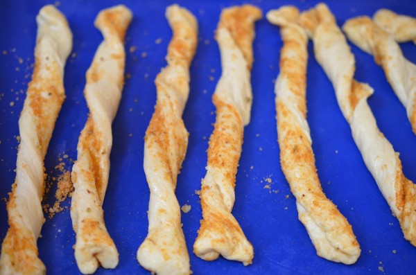 Twist each parmesan bread stick before baking in the oven.