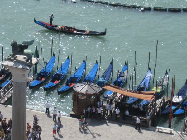 Venetian gondolas and Harry's Bar Venice, two icons of the city.