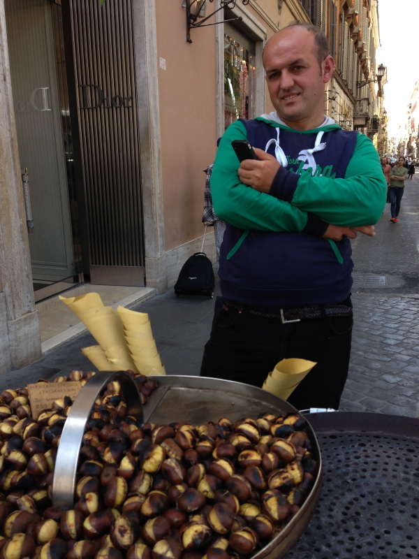 Marco sells Italian roasted chestnuts on the Via Condotti in Rome and serves them in little paper cones.