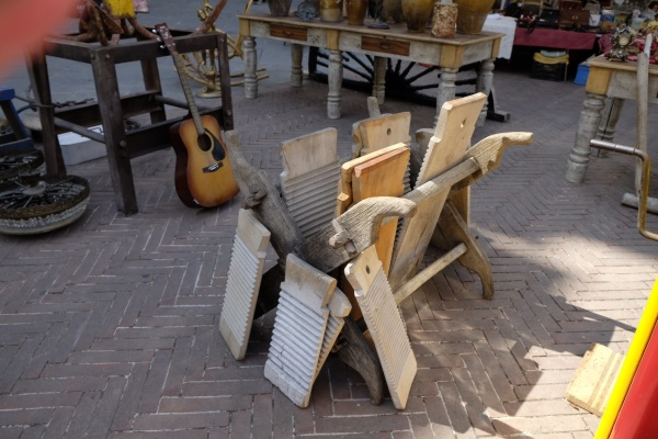 Old washboards, old tables and a lonely guitar.