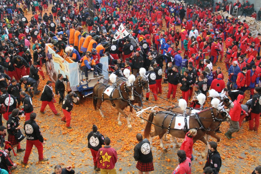 Carnevale food fight with oranges in Ivrea, Italy, a messy annual tradition.