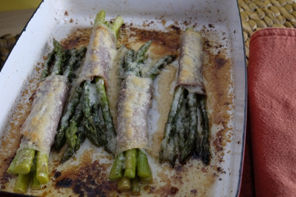 Baked asparagus bundles include prosciutto and parmesan cheese.