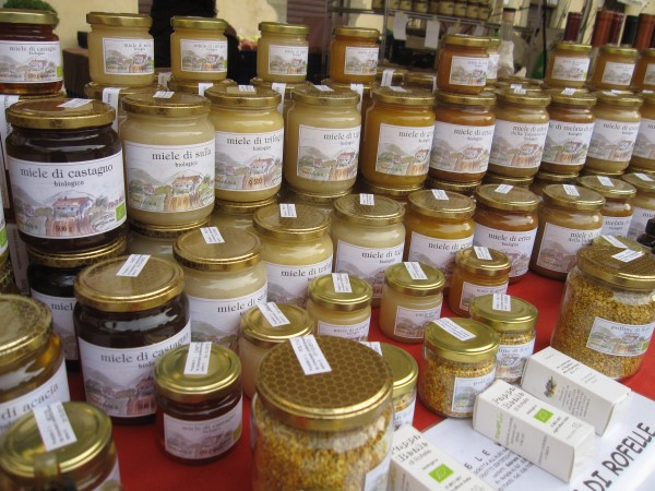 Organic honey on sale in Sansepolcro's outdoor market.