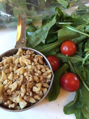 The main ingredients for this great summer pasta dish: walnuts, cherry tomatoes and arugula.