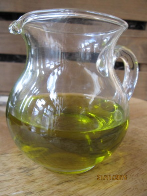 A close up of this luscious olive oil that is the key ingredient in your olive oil pound cake with spices.