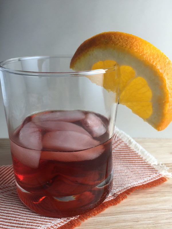 The perfect Negroni is just as good on the rocks with accompanied by an orange peel.