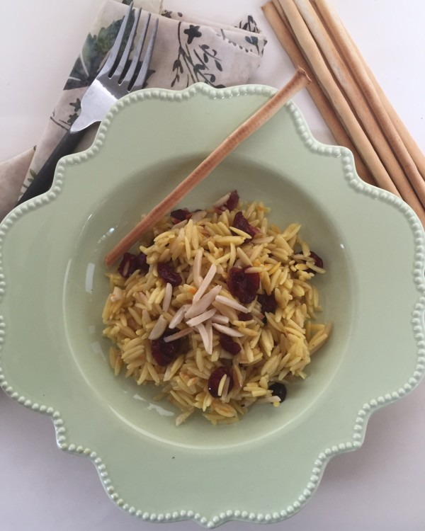 Orzo with dried cranberries and almonds is a year-round dish with beef, pork or chicken.