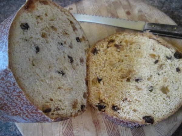 Ice cream panettone starts with slicing the bottom off the bread.