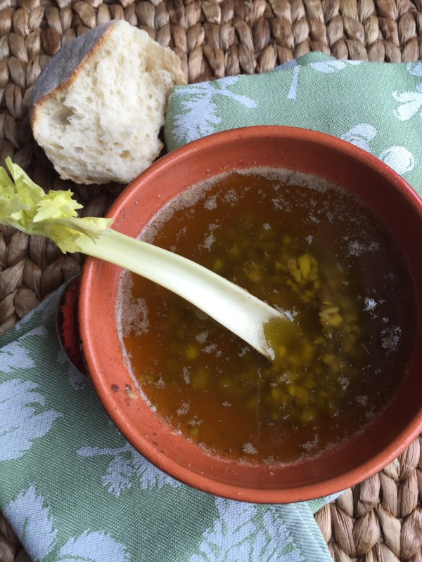 Serve bagna cauda with different cut vegetables and some bread.