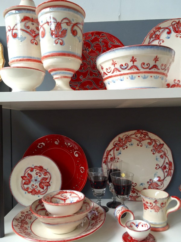 Red and soft blue Italian ceramics add punch to any dinner table.