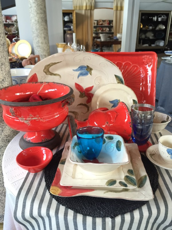 The bold red Italian ceramics go well with the floral motif of the serving dishes.
