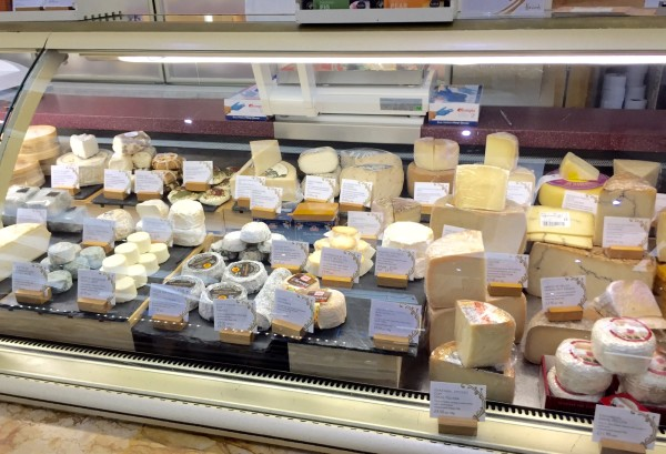 Stroll through Harrod's cheese department.